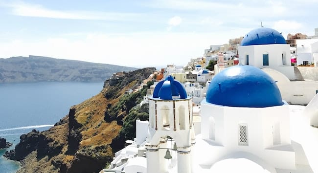 Beautiful white houses with blue roofs on Santorini in Greece